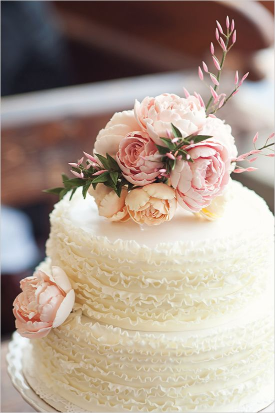 The delicate layers of this cake seem to mimic a wedding dress.  Almost too pretty to eat!    Photo:  Oh, Darling!