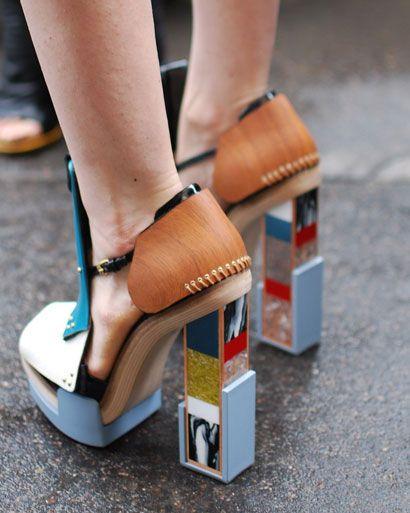 A unique pair of Balenciaga shoes brings light to the rainy pavement