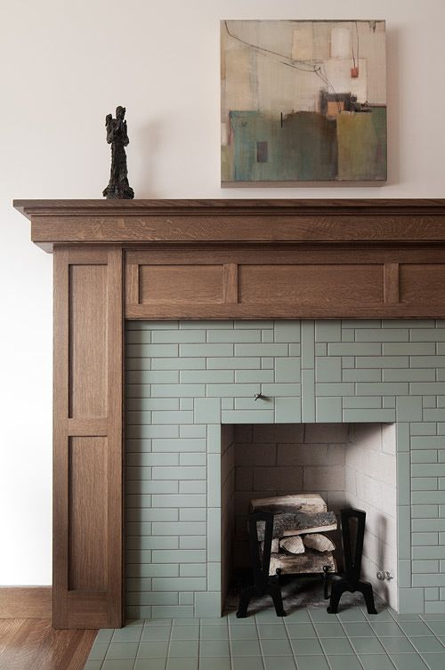 fireplace mantel...mix of warmth and cool...traditional and modern.