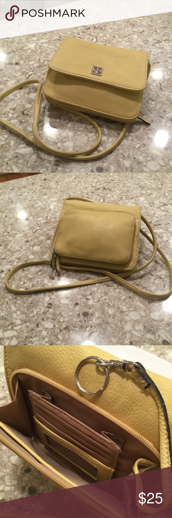 """Gianbernini yellow pebble leather cross body Excellent condition.  No wear and tear.  Interior spotless. YELLOW. Exterior:  outside zip pocket, 4 credit card slots, cell phone pocket, open pocket with key chain. Also, under flap, zip pocket. Interior:  3 pockets with back zip pocket. 2nd cell phone pocket.  Plenty room for iPhone six plus. 25"""" strap. 8 1/4 x 7 x 3 gianbernini Bags Crossbody Bags"""