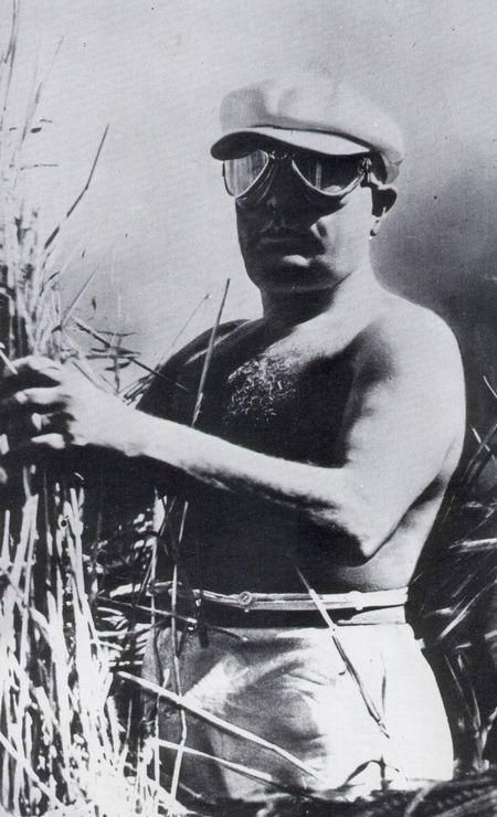 "Shirtless Mussolini harvesting wheat in 1925 during the so-called ""Battle for Grain"""