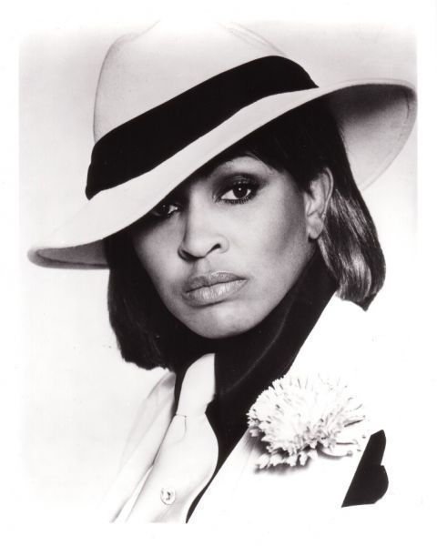 Vintage photo of Tina Tuner in fierce black & white hat!
