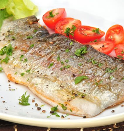 Lemon and ginger are the main flavors in this exciting grilled trout recipe, although you can swap the lemon for lime if you prefer. These ingredients give a nice tang to the trout, and the recipe is further enhanced with cilantro and red pepper flakes. Use a pinch of ground ginger if that is all you have but fresh ginger gives the finished recipe a better, fresher taste. The same applies to the lemon juice - use fresh lemon juice if you can.