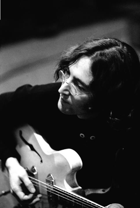 "John plays guitar during a recording session for the album ""The Beatles"" (White Album)"
