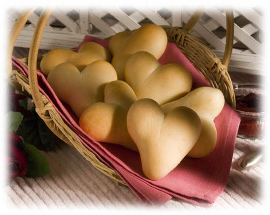 Heart-Shaped Dinner Rolls:  Warm their hearts this Valentine's Day with warm-from-the-oven Valentine Dinner Rolls.