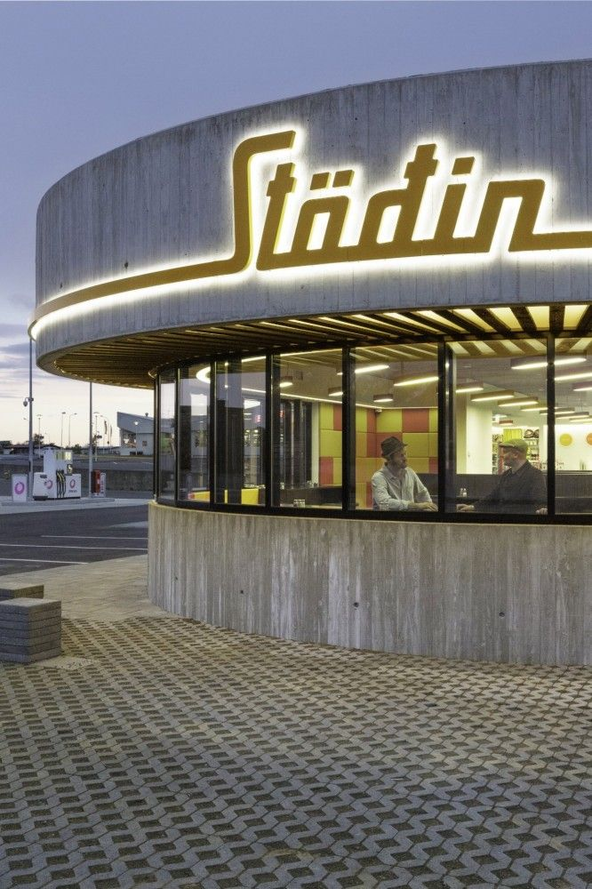 """Stöðin"", a roadside stop in the Icelandic countryside, is a conjoined restaurant, drive-through, convenience store and gas station."