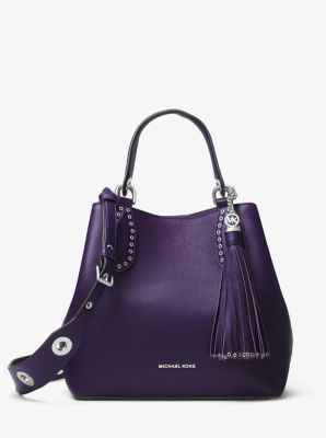 Designed to go anywhere, the Brooklyn tote boasts seasonless appeal in an expansive silhouette crafted from pebbled leather. Polished grommets and an oversized tassel lend tactile edge, while the brand's logo gives a refined nod to signature glamour.