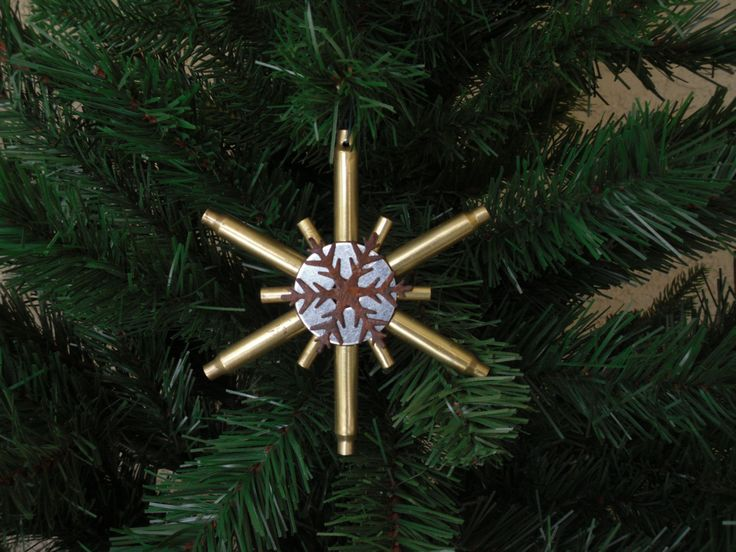 This item uses 223 and 22 casings for an outstanding look!  We used recycled brass ammunition casings to bring rustic authenticity to each snowflake adding character and charm to each piece.  For that someone who is hard to shop for but loves the outdoors, this might just be a fun option for an unusual decoration!  This piece is approximately 5 inches across and about 5/8 inch thick.  There will be variations in color, scratches, tarnish, rust and dents due to recycled nature of this…