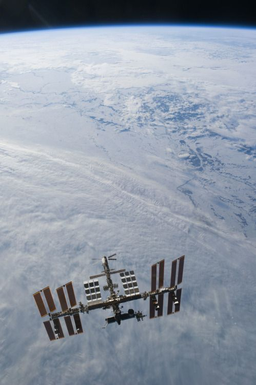 March 7, 2011 – Views of the International Space Station high above the Earth, photographed from the Space Shuttle Discovery after undocking.