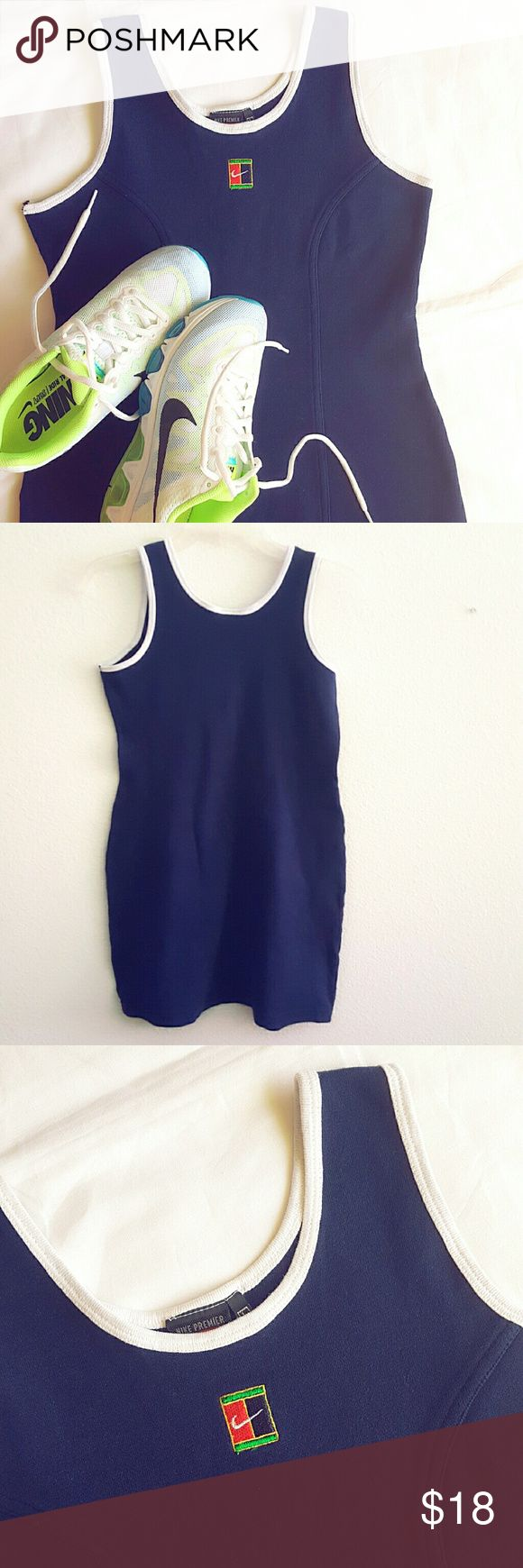 Nike dress Nike Premier, dark blue 100% cotton. Beautiful, sporty and classy. Fitted form and stretchy, to better meet performance needs. Hits mid thigh. Preloved, in really good condition,  only flaws are two small tears on armpits (see last pic). Nike Dresses Mini