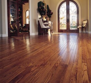 Dark Bamboo wood flooring... I heard on HGTV that bamboo flooring is not only eco-friendly but great for familys with dogs and kids! Apparently its virtually  un-scratchable!