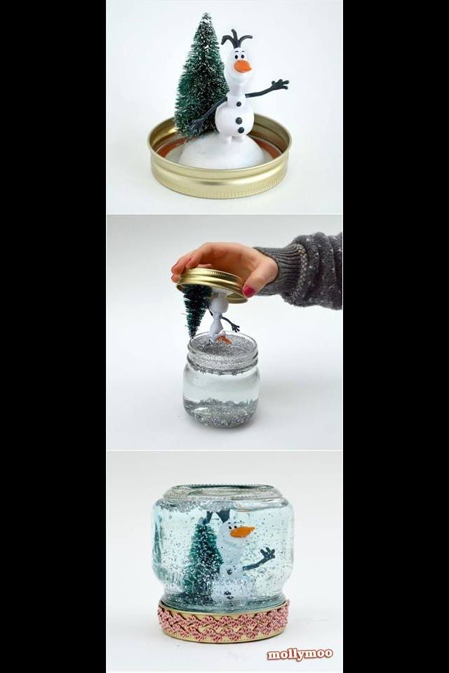 DIY snow globe. Get a small mason jar, glue figures to the bottom of the lid, fill with water and glitter, and seal tightly. Snow globe!!
