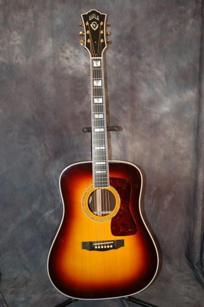 Today, Lawman Guitars is Presenting...  An Incredible 2013 Guild D-55 Dreadnought Acoustic Guitar with original Hardshell Case....the top of the line for Guild Guitars and this one is terrific....This is the third D-55 I have had and sold the other two jet quick. Give us a call. Lawman Guitars. 515-864-6136