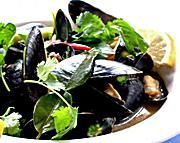 This fragrant steamed mussel recipe makes a superb gourmet appetizer to serve guests or that very-special-someone in your life. Thai herbs and spices, such as lemongrass, lime leaf, fresh coriander and basil, create a wondrous broth that marries perfectly with the taste of the mussels without ever overpowering them. This mussel recipe is simple to put together too - ready in just minutes. Pair with a nice wine and good company. ENJOY!