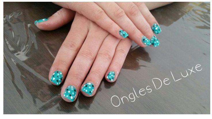 Turquoise and polka-dot white black nails