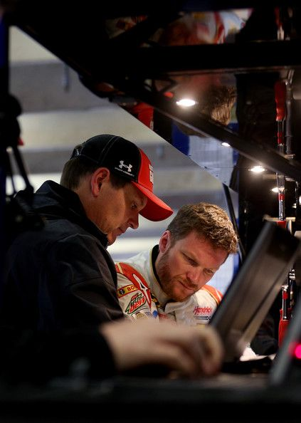 Steve Letarte Photos Photos - Dale Earnhardt Jr., driver of the #88 National Guard Chevrolet, speaks with his crew chief Steve Letarte in the garage during practice for the NASCAR Sprint Cup Series Duck Commander 500 at Texas Motor Speedway on April 5, 2014 in Fort Worth, Texas. - Texas Motor Speedway - Day 3