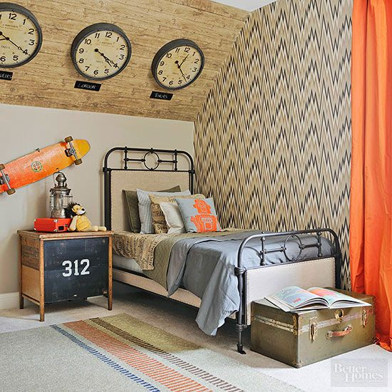 Can we say, we're totally jealous of the kid that gets to sleep in this bedroom? In addition to the fabulous industrial decor and fun pops of orange, trendy wood paneling and a flame stitch wallpaper turn up the style quotient on the walls. http://www.bhg.com/decorating/lessons/expert-advice/decorating-with-wallpaper/?socsrc=bhgpin031515kiddoswallpaper&page=16