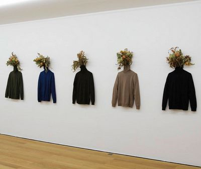 """Gallerylike installation--shows sweater to full advantage, adds color and texture with """"head"""" treatment."""