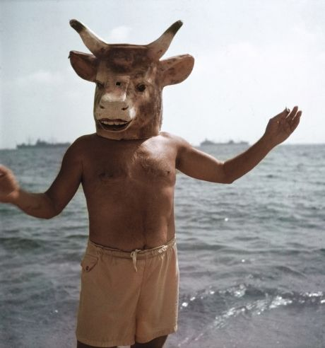 On the beach at Golfe-Juan in 1968, Mili captures Picasso reveling in two of his artistic obsessions: the mask and the minotaur, a mythical half-bull, half-man that featured prominently in much of his work.