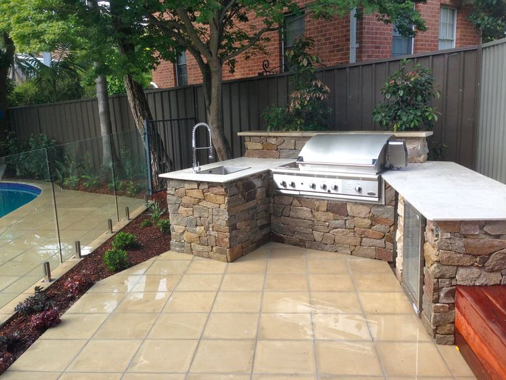 Outdoor kitchen, pool area, landscape design, paving, timber bench seat