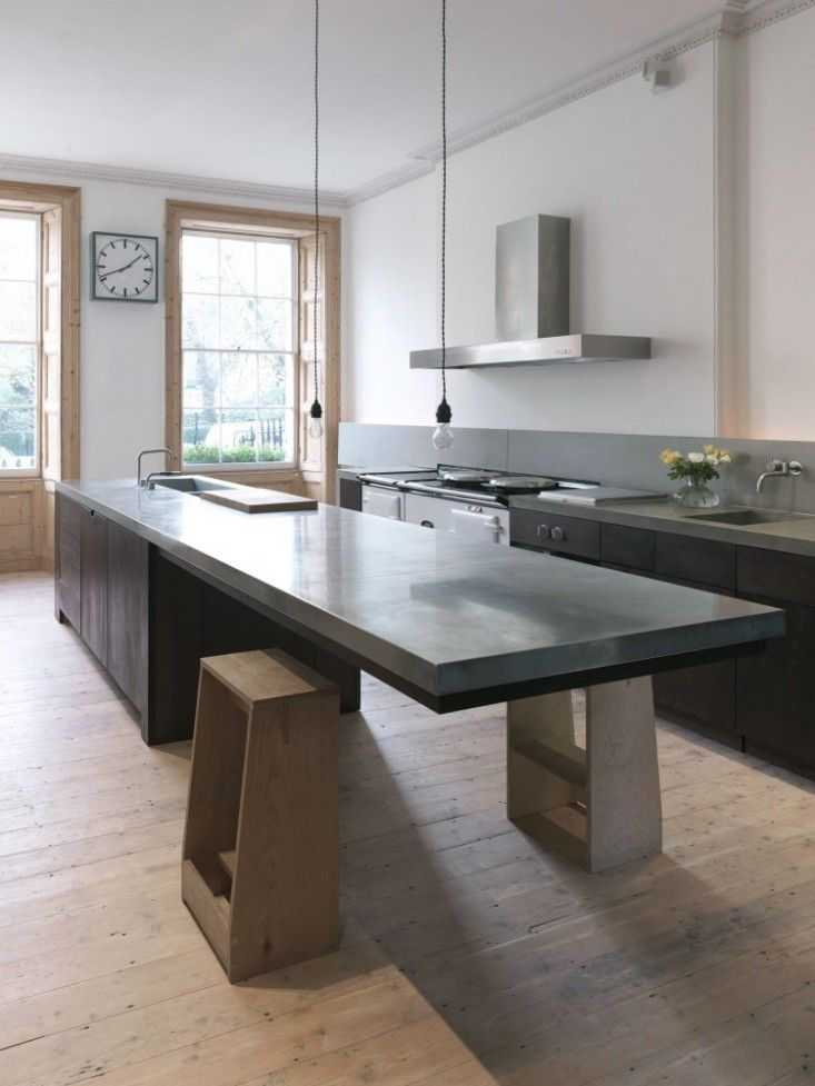 Love the stools. McLaren.Excell Marylebone House, minimalist kitchen, zinc island | Remodelista