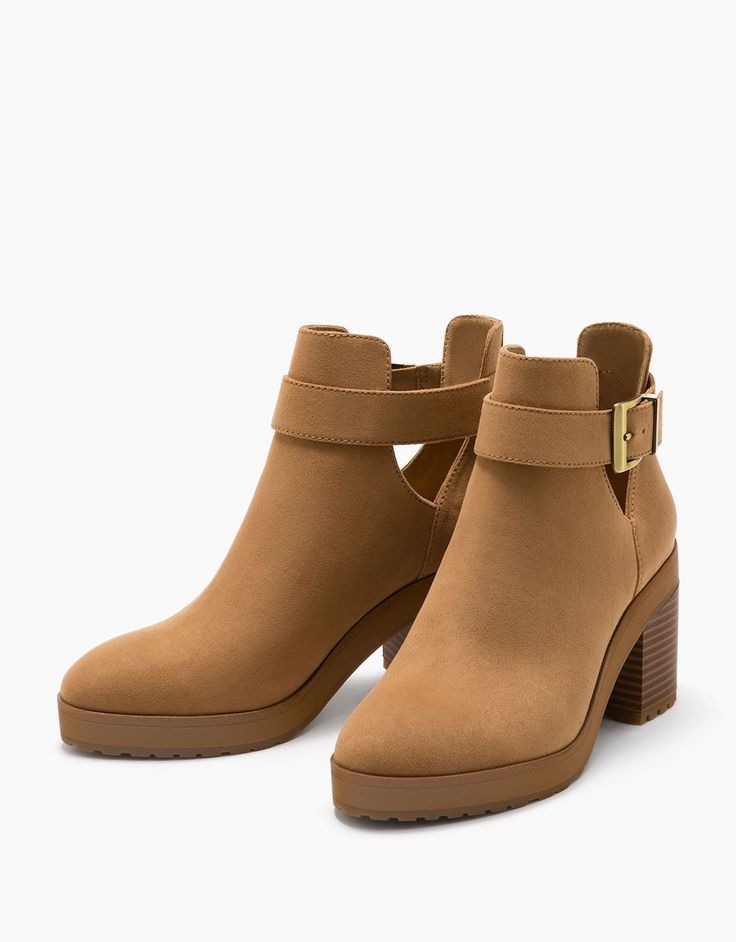 Mid heel ankle boots with openings and buckle. Discover this and many more items in Bershka with new products every week