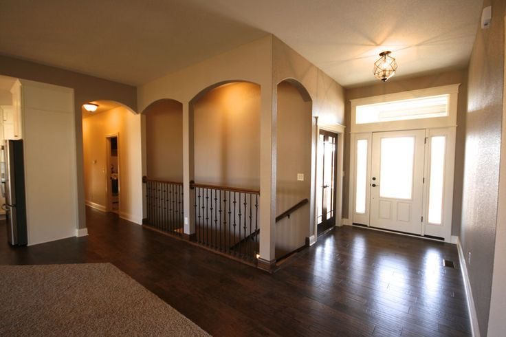 Open staircase to basement altoona custom ranch by mj for Custom home floor plans with basement