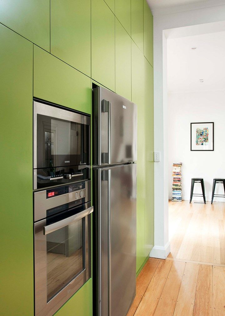 70s kitchen makeover The owners chose the shade of green because it fits well with the Danish modernist tradition they love | Home Beautiful magazine Australia