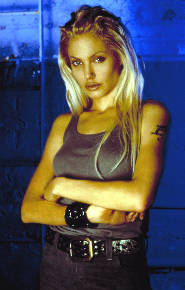 Pin for Later: Look Back at Angelina Jolie's Sexiest, Most Scintillating Pictures Through the Years  Angelina rocked platinum blond locks in 2000's Gone in 60 Seconds.