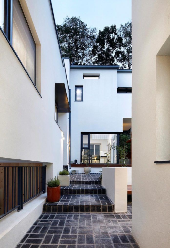 House embraced by the forest designed for