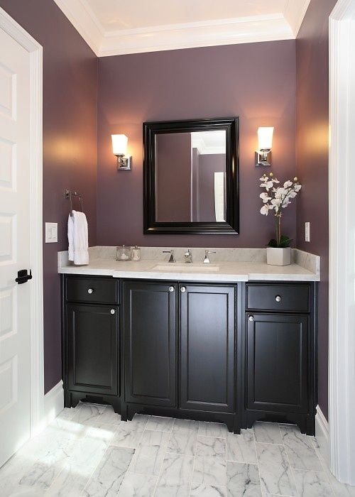 This just might be my inspiration for the laundry room! Purple walls and black cabinets.