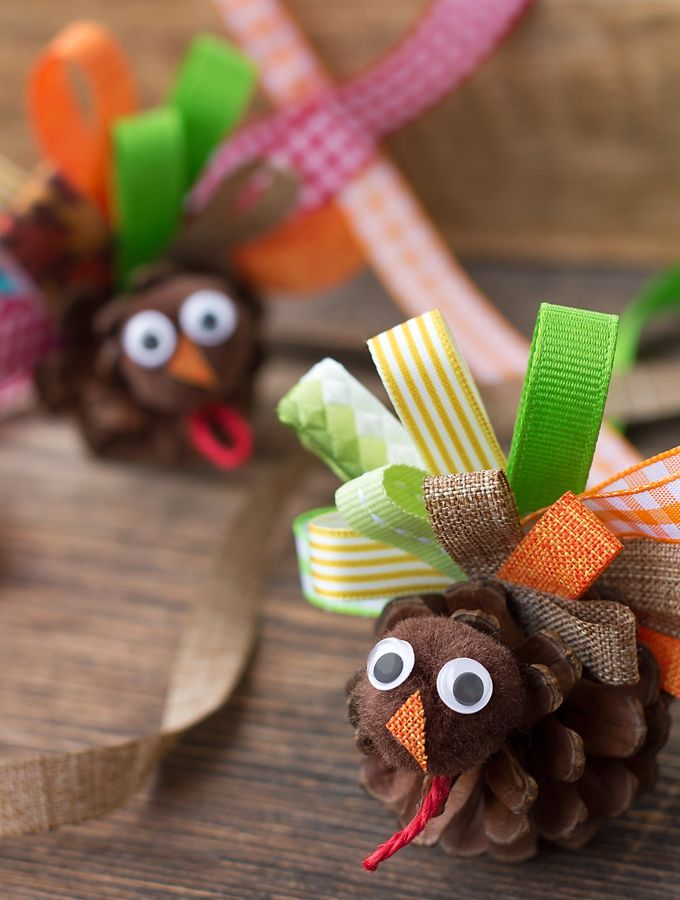Children of all ages will enjoy these simple and Scrap Ribbon Pinecone Turkeys, perfect for Thanksgiving.