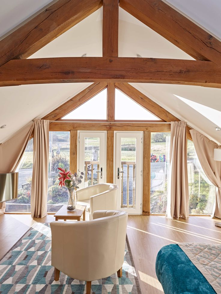 Tynrhyd Retreat – Commercial contemporary barn complex, beautiful light living area a mix of green oak and glass | Welsh Oak Frame #living #area #relax #oak #truss #light #glazing #wood #wooden