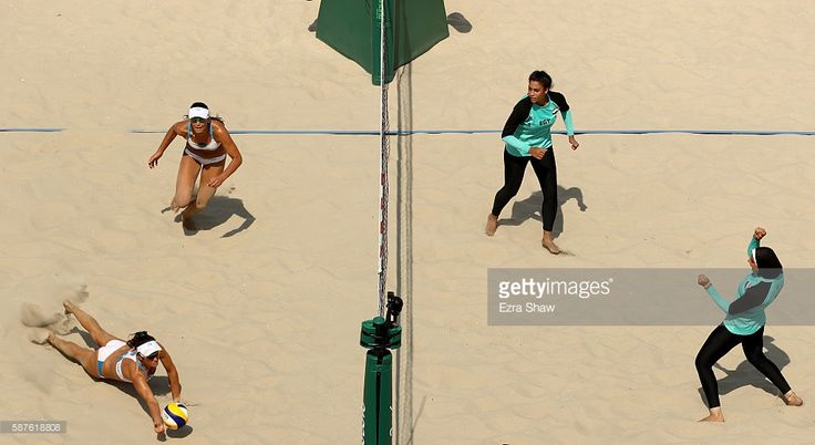 Laura Giombini and Marta Menegatti of Italy play against Nada Meawad and Doaa Elghobashy of Egypt Vietnam for the ball during the Women's Beach Volleyball Preliminary Pool A match on Day 4 of the Rio 2016 Olympic Games at the Beach Volleyball Arena on August 9, 2016 in Rio de Janeiro, Brazil.