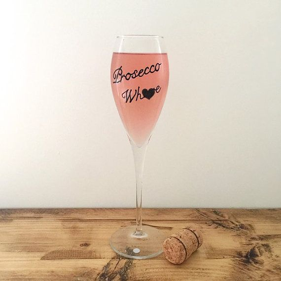 Tulip champagne glass, hand painted with the phrase Prosecco Whore.  We individually source and hand paint our designs using the best quality materials in our Somerset studio. Our beautifully defaced vintage comes gift wrapped in brown paper packages tied up with string....... these are a few of our favourite things. We also take custom orders. If you have a word or phrase in mind let us know! Gentle hand wash only to keep me beautiful. Find our latest treasures and offers on our Instagram…