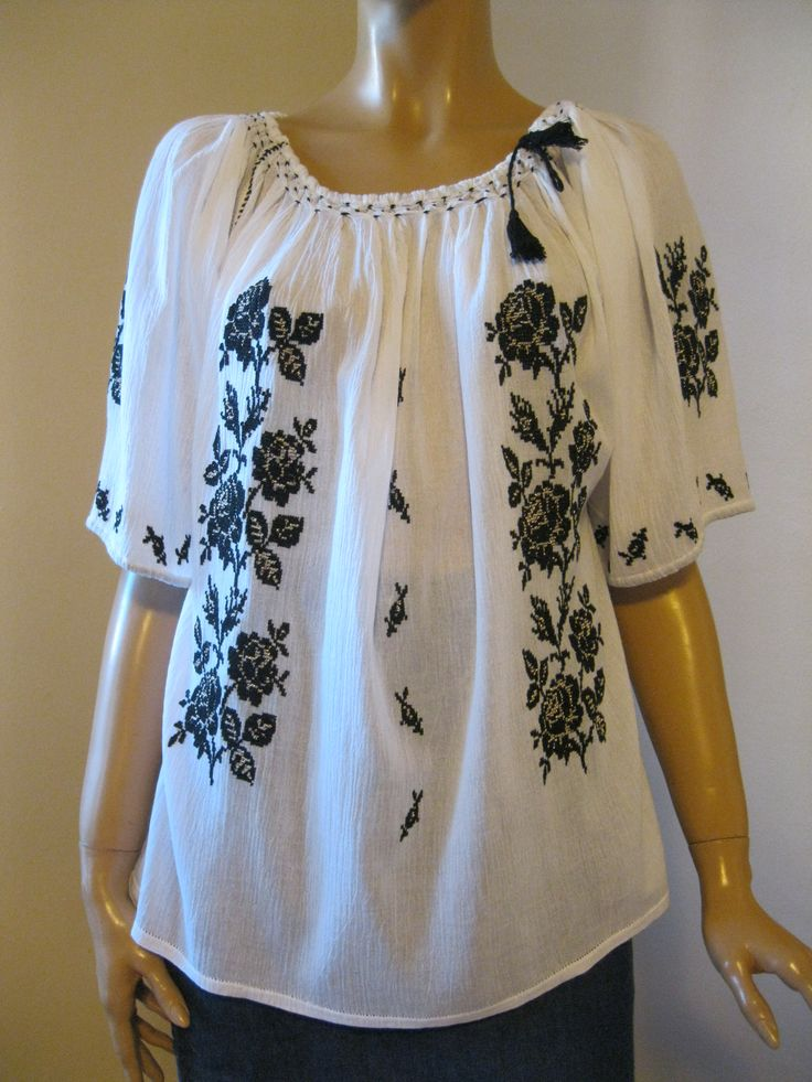 Stunning handmade Romanian peasant  blouse, hand embroidered with black cotton thread and metallic golden thread on finest gauze cotton.  Available at www.greatblouses.com