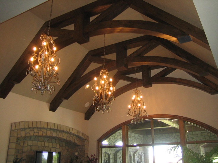arched beams fill the vaulted ceiling space nicely www