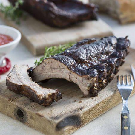 Costillas de cerdo ahumadas con salsa de arándano rojo