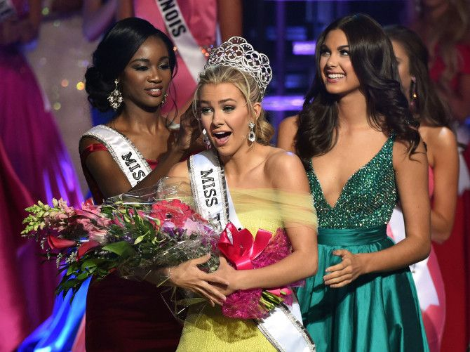 Miss Texas Teen USA 2016 Karlie Hay (center) reacts as Miss USA 2016 Deshauna Barber (left) and Miss Teen USA 2015 Katherine Haik (right) crown Hay as Miss Teen USA 2016 during the Miss Teen USA competition in Las Vegas July 30, 2016.