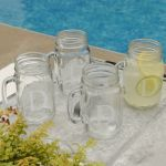 Personalized Classic Jar Glass Set    Sip your favorite drink from one of these charming Personalized Classic Ball Jar Glasses, a perfect gift for anyone who loves that country look. Both attractive and sturdy, these monogrammed glasses are ideal for any beverage and the personalization makes them a great wedding, shower, bridal party, housewarming present or a table centerpiece. Sold in sets of 4.