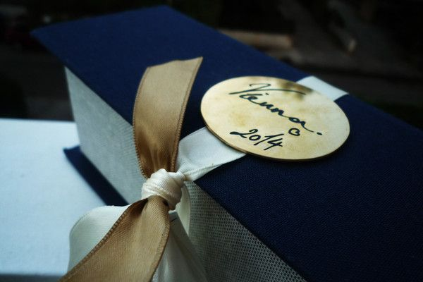 Customized linen box with your destination  engraved in gold-plated metal.