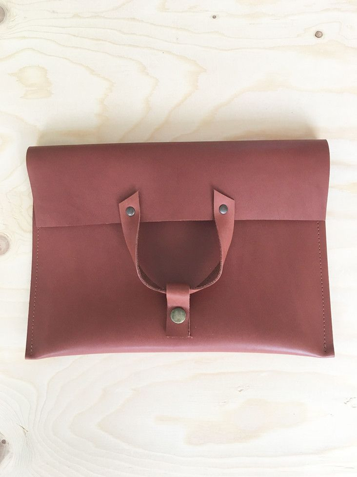 Rosy brown leather flap-over clutch | Janette van Tol