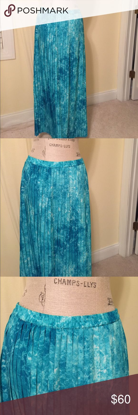 Michael Kors pleated maxi skirt. Michael Kors turquoise print pleated maxi skirt. Worn once-excellent condition. Great for spring/summer outings or to the beach. Michael Kors Skirts Maxi