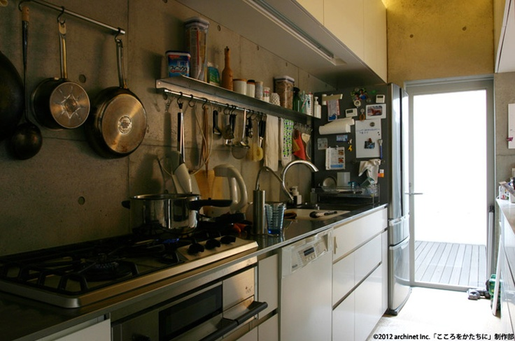 kitchen with bare concrete wall