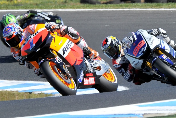 Casey Stoner leads Jorge Lorenzo early in the 2012 Australian MotoGP. (Getty)   HE'S A CHAMP!