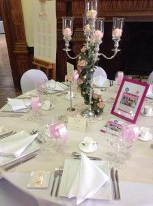 candelabra flowers around stem - with glass cups and votive candles/rose petals