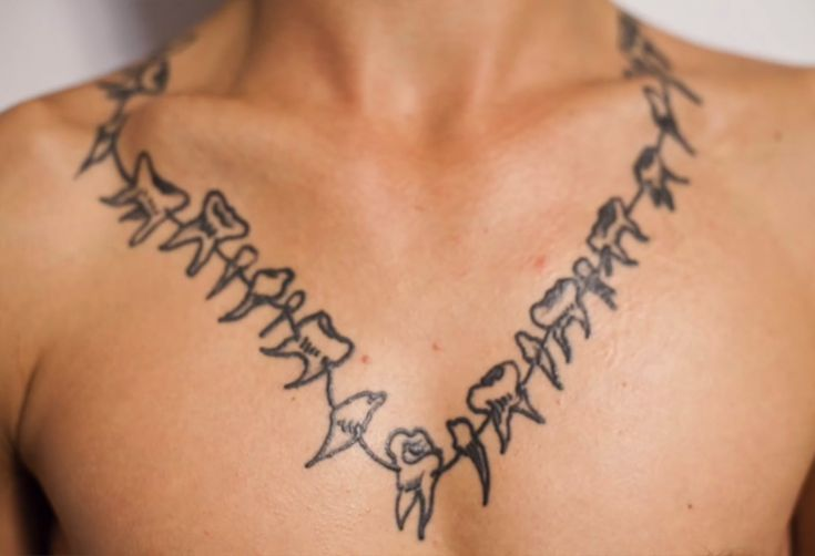 Austin Augie - the Neck tattoo - fun fact: it actually has as many teeth as a human has in its mouth - https://youtu.be/VKUtDgpRta8