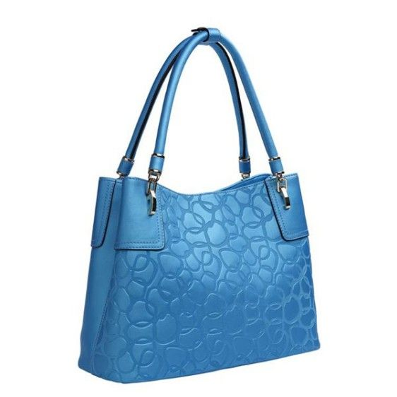 A genuine leather tote bag in a wonderful blue color. The extra long straps makes the purse easy to either carry over your shoulder or in your hand. The inside is lined with durable fabric and features two zip-locked pockets as well as two additional pockets for phones and wallets.