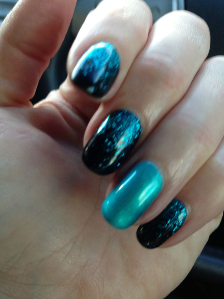 Black with green glitter and feature nail By Juren Beauty