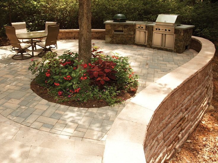 A Raised Patio Featuring The Highland Stone® Multiheight Retaining Wall  System